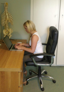 Unsafe: An ongoing trade off between poor neck/head posture and poor wrist/hand posture exists with Chiropractor Yvonne in this image